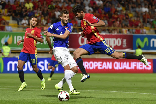 Spain routed Liechtenstein in their first World Cup qualifying match, securing a resounding 8-0 victory in Leon. Liechtenstein looked determined to keep La Roja out in the first half, before eventually crumbling and allowing the Spaniards to run rampant in the second. Diego Costa, David Silva and Alvaro Morata all bagged braces while Sergi Roberto and Vitolo also got on the scoresheet in the Group G opener. Julen Loptegui's men started well, with Diego Costa heading in a curled Koke free-kick from six-yards. However, lacking the cutting edge, they were unable to finish the job, with Koke himself scuffing a shot. Vitolo, positioned perfectly to nod in the rebound, failed to make meaningful contact. Sergio Brusquets, who was on the follow-up, shot against Vitolo in the ensuing goalmouth scramble. Spain's second goal finally arrived after 54 minutes as Nolito turned and slipped in Roberto with a clever pass and the latter's first-time toe poke beat keeper Peter Jehle. Seemingly dazed by the goal, the Liechtenstein defense fell apart and conceded three more in little more than 10 minutes. Vitolo ran behind the defense and set up Silva who hammered in off the bar from three yard. Nolito then clipped a ball into the box and a quick exchange of passes between Costa and Silva set up a simple finish for Vitolo. Costa then headed in the fifth, after being initially denied by Jehle. The keeper could not keep the second attempt out. The Chelsea man was then replaced by Alvaro Morata, who quickly joined in on the scoresheet. The Real Madrid striker scored his first with a shot that beat Jehle just inside his left-hand post after taking a slight deflection. The keeper was then left emabarassed after a simple sidefoot from Morata from the edge of the box squirmed through his grasp and over the line. Silva then completed the rout with a fine finish in injury time.