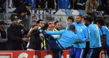 Marseille's Patrice Evra sent off for kicking out at supporter